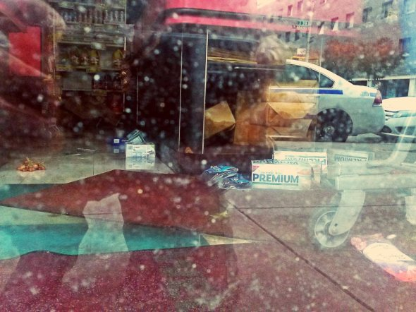 October 30th, 2012: Looking through the window of a store on Avenue C in Manhattan that had flooded during the hurricane.