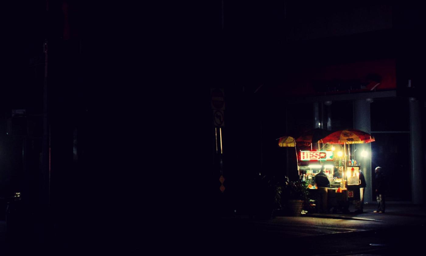 November 1st, 2012: A lone street vendor on a dark block in lower Manhattan.