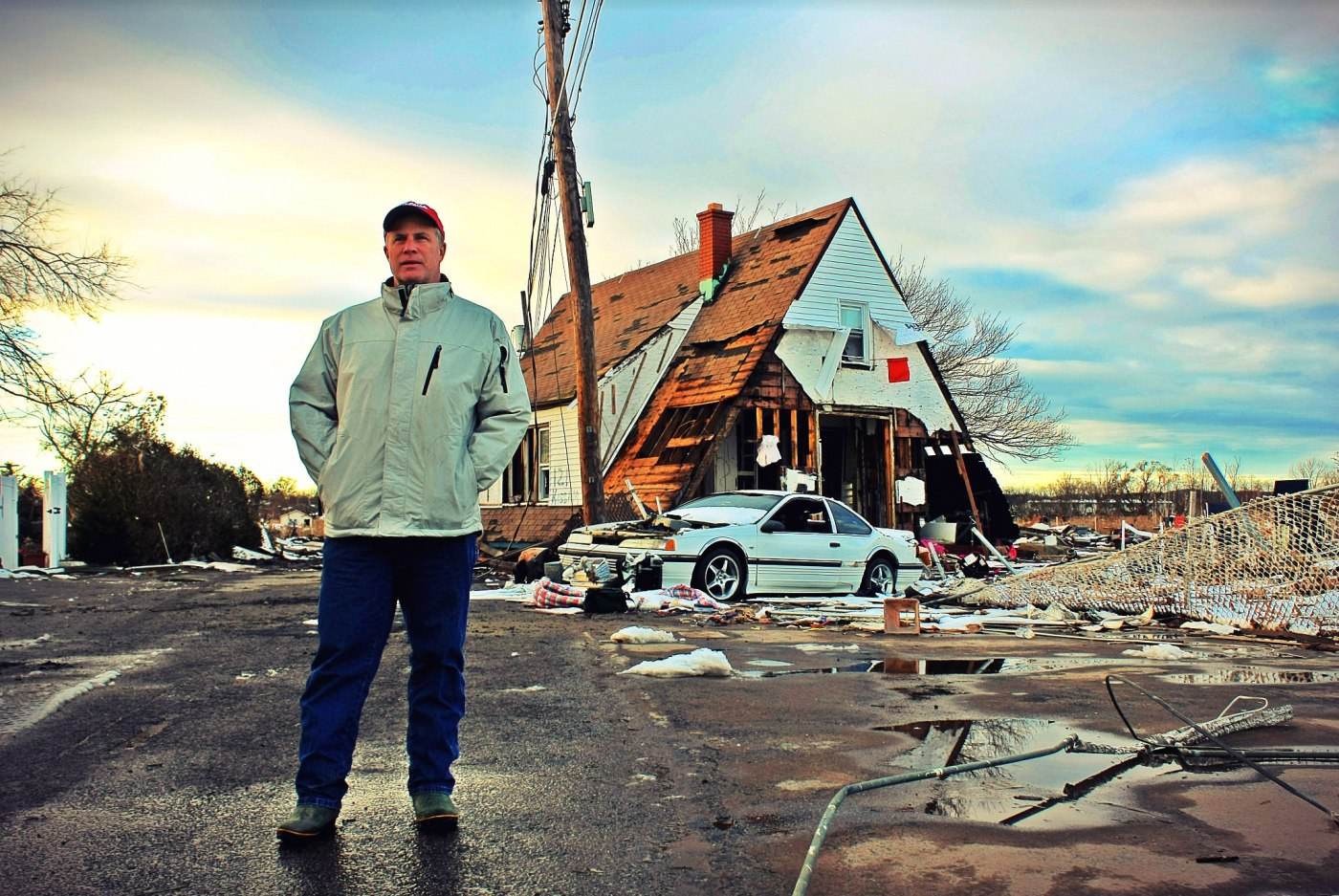 """November 8th, 2012: """"Hi, I'm Pastor Joseph, and this used to be my house."""" Pictured in the background is the top level of what used to be his house on Kissam Ave in Staten Island. The foundation of his house was behind me as I was taking this photo."""