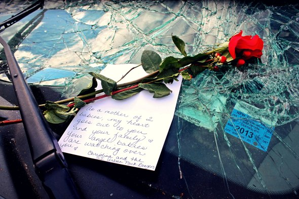 "November 3rd, 2012: A rose and a note left on a car in Staten Island that belonged to a woman who abandoned the car after it was overtaken by flood water during Hurricane Sandy. She had her two sons with her - 2 and 4 years old - and they were ripped from her arms by the rising water and drowned. The note says: ""As a mother of two babies, my heart goes out to you and your family. Your angle babies are watching over you. - Christina and the SI Urban Park Rangers"""