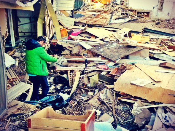 November 5th, 2012: My friend Giles taking a photo of a home that was destroyed in New Dorp Beach, Staten Island.