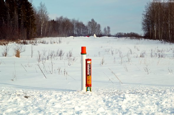 In the foreground of this photo is a post that marks one of 4 Enbridge tar sands pipelines that illegally run through Red Lake tribal land in Northern Minnesota. In the background, you can see a tipi that is part of an encampment that sits directly above the 4 pipelines, which is an attempt to shut down the pipelines.