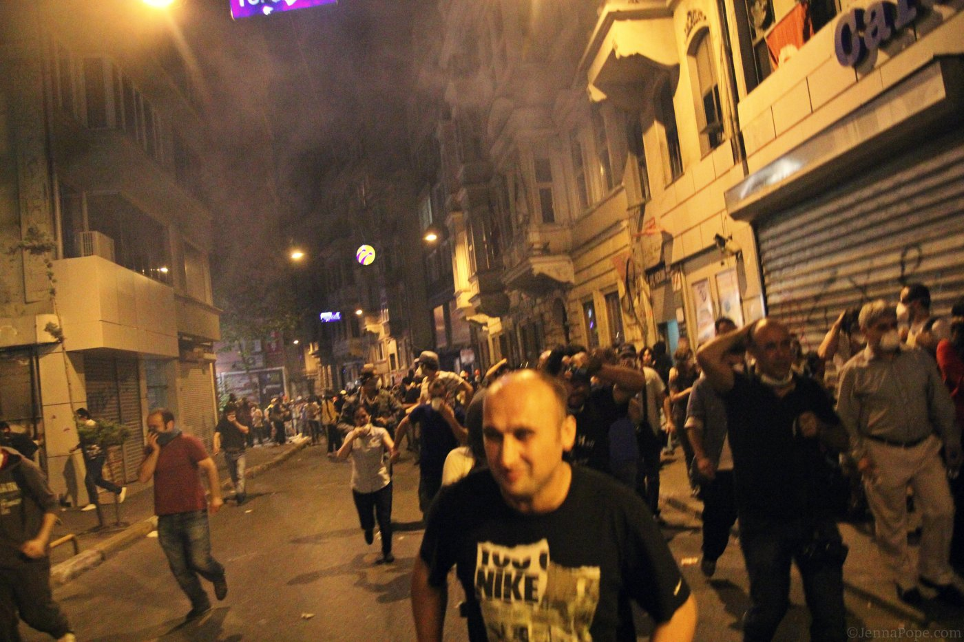 Tear gas hanging in the air above protestors as they are pushed further from Taksim Square.