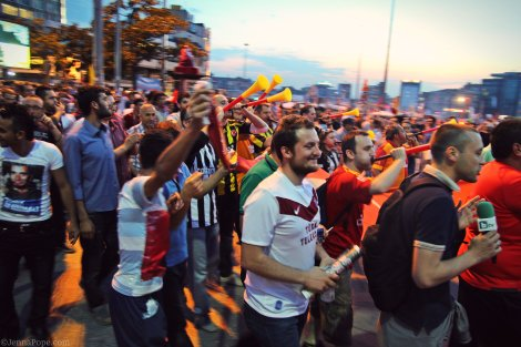 Sports fans, who played a large role in the protests in Istanbul, march through Taksim Square.