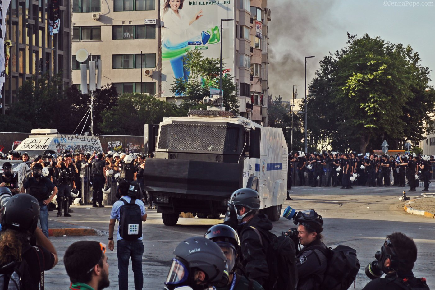 Hundreds of police officers, along with water cannon trucks, sitting in Taksim Square.
